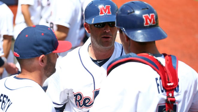 Ole Miss hitting coach Mike Clement (center) has guided the Rebels' offense from the bottom of the SEC in batting average in 2017 to the top of the league in '18.