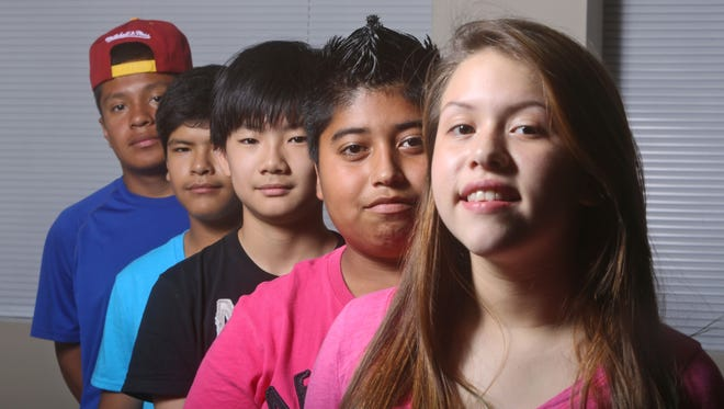 Members of the Westchester County Youth Council's Youth Council, from right, Leilani Orozco, 13, of White Plains, Estuardo Lopez, 13, of Mamaroneck, Ethan Park, 11, of Eastchester, Oscar Hutarra, 13, of White Plains, and Ivan Vasquez, 15, were photographed Nov. 16, 2014.