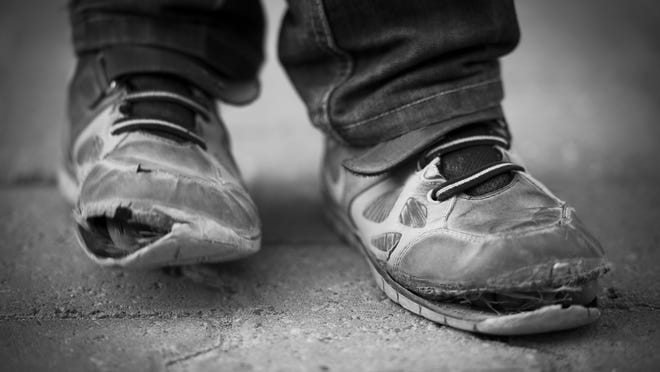 There were nearly 250,000 Wisconsin children living in poverty in 2012 — almost one in five in the state.