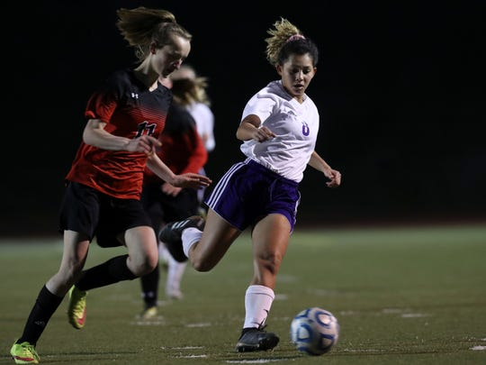 Shasta's Alexis Highfill moves the ball past Foothill's