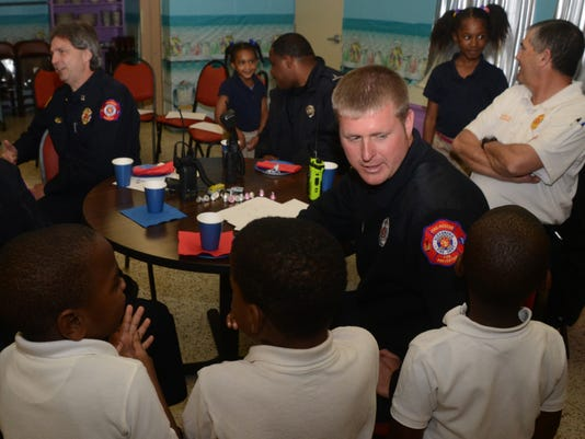 ANI Cookies for Courage Justin Bonnette with the Alexandria Fire Department talks with pupils at Horseshoe Elementary School Wednesday, Jan. 28, 2015. Students at the school showed their appreciation for members of the Alexandria Fire Department and Alexan