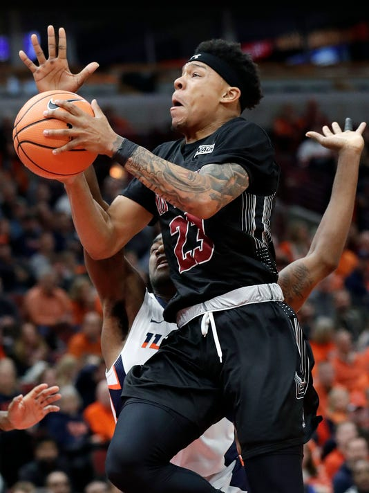 New Mexico State guard Zach Lofton (23) drives to the basket against Illinois guard Da'Monte Williams during the first half of an NCAA college basketball game Saturday, Dec. 16, 2017, in Chicago. (AP Photo/Nam Y. Huh)