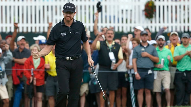 Jimmy Walker reacts after making a birdie on the 17th hole during the final round of the PGA Championship golf tournament at Baltusrol Golf Club in Springfield, N.J., Sunday, July 31, 2016. (AP Photo/Mike Groll)