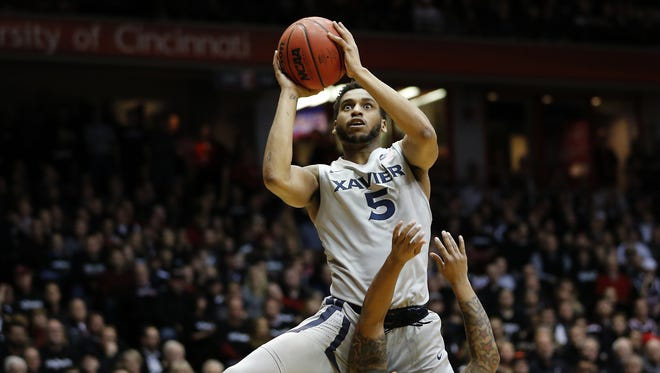 Xavier Musketeers guard Trevon Bluiett (5) goes up for a shot in the first half.