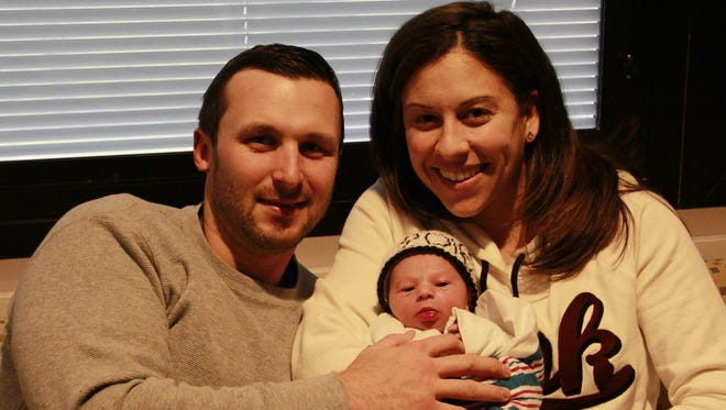 Brian McKenna and wife Allyson hold their son, Colin, the first baby born in Hunterdon County in 2016.