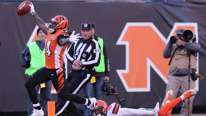Cincinnati Bengals cornerback Adam Jones (24) scores a touchdown on a punt return that was called back for an illegal block in the back during the Week 12 NFL game between the Cleveland Browns and the Cincinnati Bengals, Sunday, Nov. 26, 2017, at Paul Brown Stadium in Cincinnati.