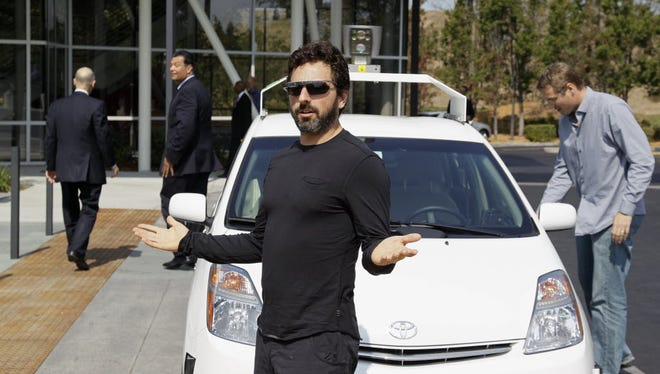 Google co-founder Sergey Brin after riding in a driverless car at Google headquarters in Mountain View, Calif., in September 2012.