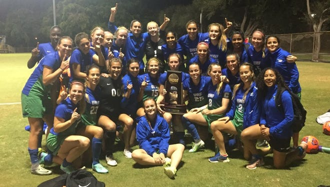 The UWF women's soccer team gathers to celebrate beating Barry 1-0 to win the NCAA South Region championship in Miami.