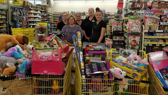 Houston County Toy Drive shopping for toys at Dollar General and Family Dollar.