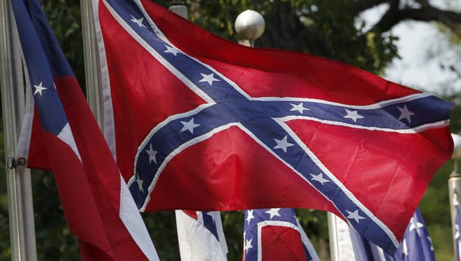 In this 2011 file photo, Confederate battle flags fly outside the museum at the Confederate Memorial Park in Mountain Creek, Ala.