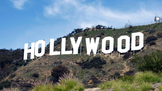 This Jan. 29, 2010 file photo, the Hollywood sign sits near the top of Beachwood Canyon adjacent to Griffith Park in the Hollywood Hills of Los Angeles.