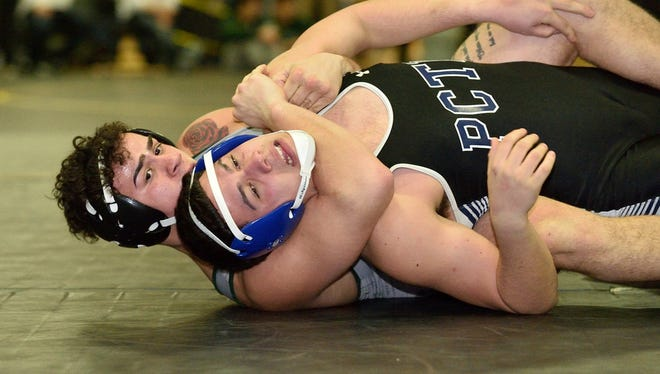 Michael Pillot of DePaul, left, and Joshua Acevedo of Passaic Tech wrestle in the 182-pound final at the Passaic County Coaches Association Wrestling Tournament in West Milford.