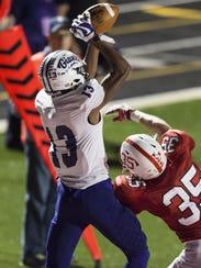 Ben Davis senior Broc Thompson (13) pulls in a touchdown
