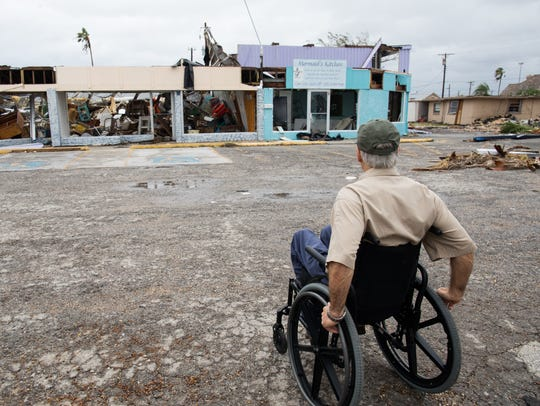 Gov. Greg Abbott looks over  damaged stores in Rockport,