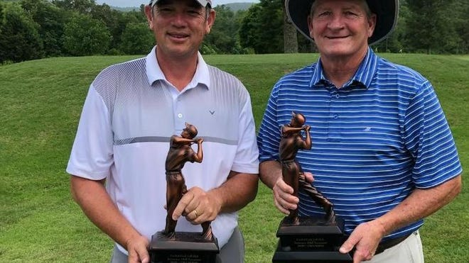 Shane Grumbles, left, and Todd Henley pose after earning the win on Sunday at the Crooked Creek Golf Club 52nd Anniversary Tournament at Crooked Creek.