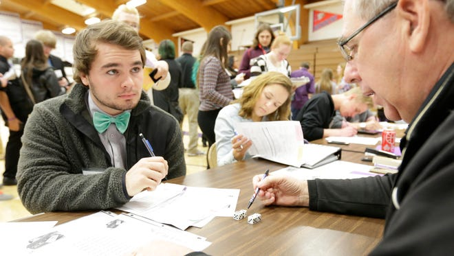 Chase Wiedow works on his budget to pay for gasoline during Wednesday's Real Life Academy at Mosinee High School.