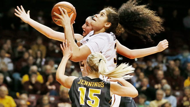 Minnesota center Amanda Zahui B. (32) shoots as Whitney Jennings (15) defends during an NCAA college basketball game Tuesday, Feb. 17, 2015, in Minneapolis. (AP Photo/Star Tribune, Jerry Holt) MANDATORY CREDIT; ST. PAUL PIONEER PRESS OUT; MAGS OUT; TWIN CITIES LOCAL TELEVISION OUT