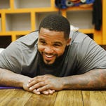 Texas Rangers first baseman Prince Fielder reacts during a pilates session with his wife, Chanel Fielder, in Winter Garden, Fla., on Jan. 27, 2015.