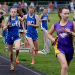 Bath's Kelsey Billingsley gets the baton from teammate Melissa Schott en route to a first-place finish during the finals of the girls 3,200 meter relay in a Division 3 regional last week.