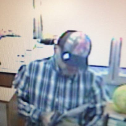 The suspect in Friday's robbery is described as a white,