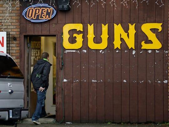 A man walks into a gun shop in Seattle in 2012. The