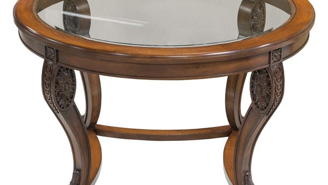 The solid mahogany Edwin Entry Table features a round glass top.