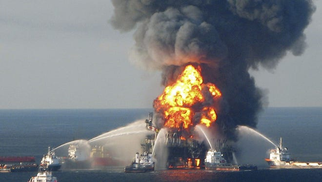 Fire boats battle the blazing remnants of the off shore oil rig Deepwater Horizon, off Louisiana, in this April 21, 2010 handout file photo. BP Plc promised improved drilling practices on July 15, 2011 as the company  balances twin aims of rebuilding investor and public confidence  after the Gulf of Mexico oil spill while not admitting flaws in  its own procedures.      REUTERS/U.S. Coast Guard/Handout (UNITED STATES - Tags: DISASTER ENERGY) FOR EDITORIAL USE ONLY. NOT FOR SALE FOR MARKETING OR ADVERTISING CAMPAIGNS