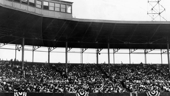 A Victory Field (Bush Stadium) crowd bought $55,900 worth of war bonds and stamps in this undated image.