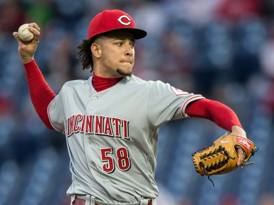Cincinnati Reds starting pitcher Luis Castillo throws during the first inning of the team's baseball game against the Philadelphia Phillies, Wednesday, April 11, 2018, in Philadelphia. (AP Photo/Laurence Kesterson)