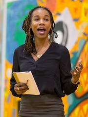 Nia Nunn, of Ithaca, delivers the keynote address Wednesday evening during the Southside Community Center's celebration of Kwanzaa.