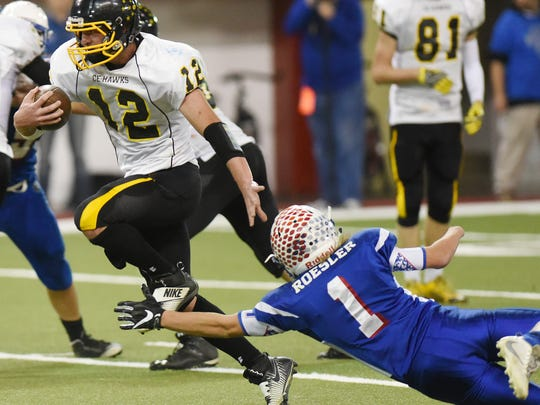 Colman-Egan's Bodee Groos escapes from Warner's Jaden Roesler during the South Dakota Class 9A High School football championship on Thursday at the DakotaDome in Vermillion.