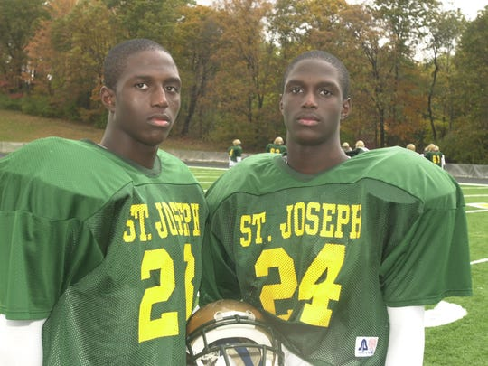 Twins Jason McCourty (left) and Devin McCourty (right) during their junior season at St. Joseph in 2003.
