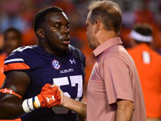 Auburn defensive coordinator Kevin Steele talks to Auburn linebacker Deshaun Davis during warm-ups prior to a game against Clemson on Sept. 3, 2016, in Auburn, Ala.