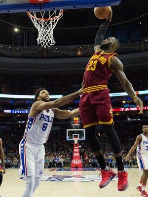 Cleveland Cavaliers forward LeBron James (23) dunks past Philadelphia 76ers center Jahlil Okafor (8) during the first half at Wells Fargo Center.