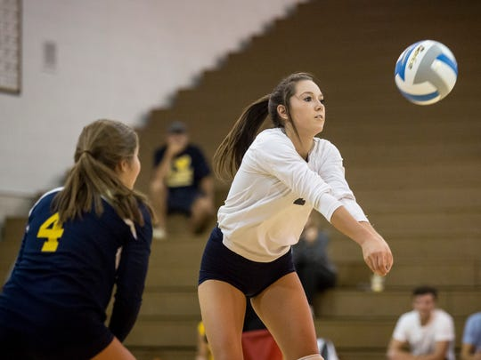 Port Huron Northern senior Kira Scahill digs the ball during a volleyball game Thursday, September 15, 2016 at Port Huron Northern High School.