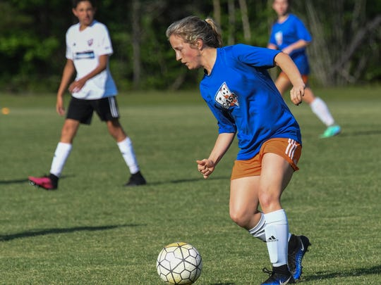 Wren High School standout Kat Syracuse practices with the CASA soccer team at Nettles Park in Pendleton on Thursday. The team is preparing for a tournament in Oklahoma.