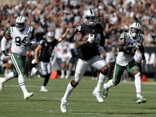 CORRECTS TO TOUCHDOWN NOT TOUCHDOWN RECEPTION - Oakland Raiders wide receiver Cordarrelle Patterson (84) runs toward the end zone to score a touchdown during the second half of an NFL football game against the New York Jets in Oakland, Calif., Sunday, Sept. 17, 2017. (AP Photo/Marcio Jose Sanchez)