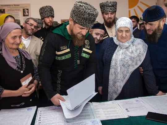 Chechnya's leader Ramzan Kadyrov votes during Russian
