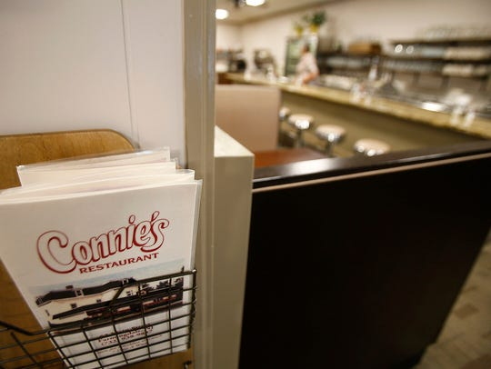 A menu waits for customers inside Connie's Restaurant