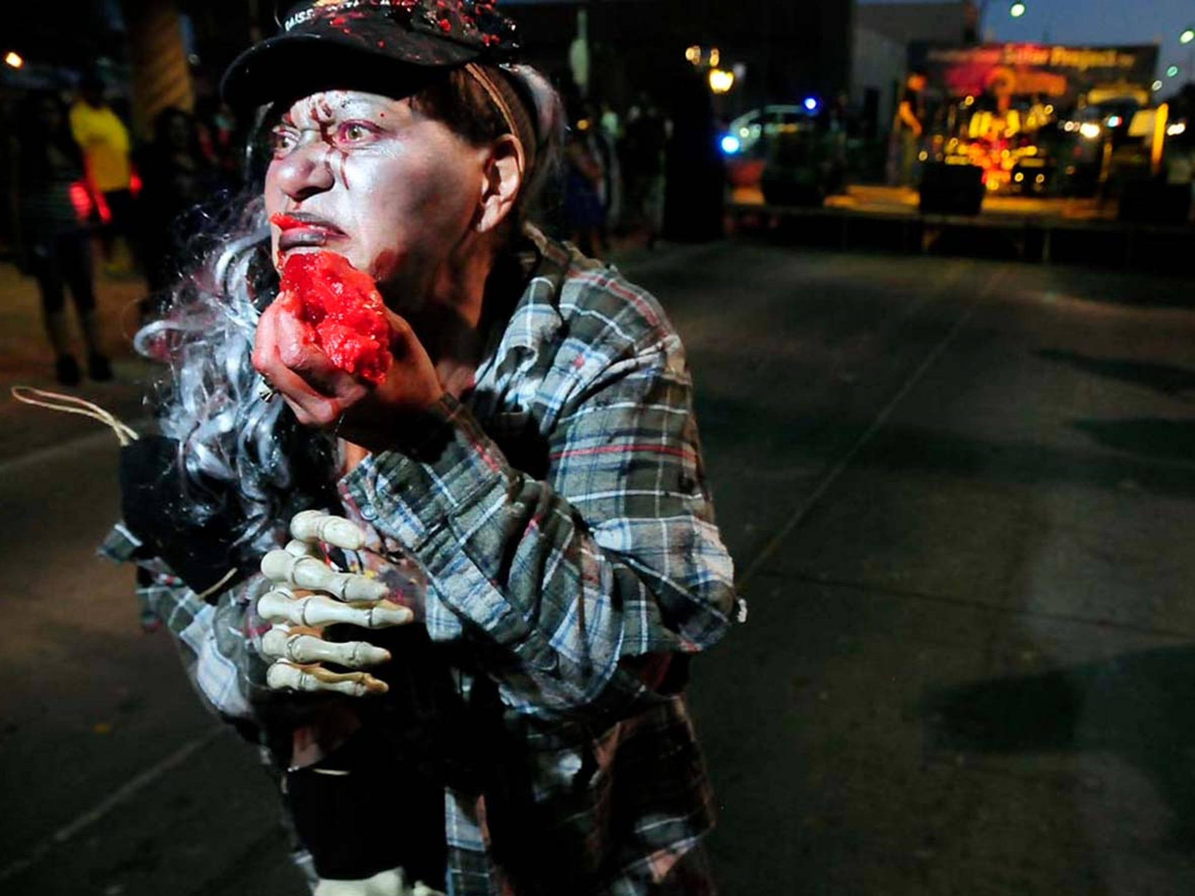 Lani Cooper, of Las Cruces, eats Jell-O brains during last year's Zombie Walk on Main Street. Attending the event is free, however there is a small registration fee for participants. All ages are welcome.