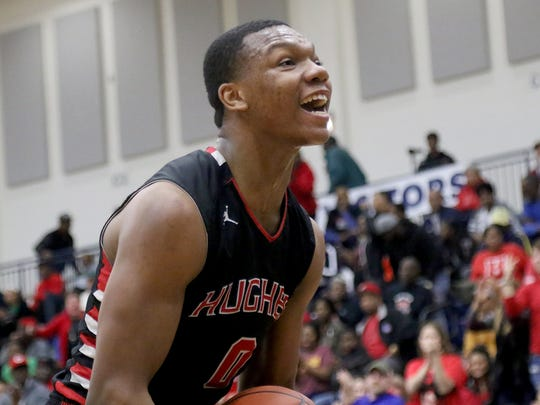 Hughes' Shawn Hawkins reacts during the Big Red's regional final against Trotwood Madison, Saturday, March 17, 2018.