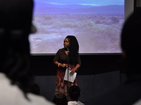 Sha'Condria Silbley, slam poet and Alexandria native, performs a spoken word that brought tears to many in her audience Thursday at a Louisiana College student-run event  intended to reduce the stigma surrounding mental illness.