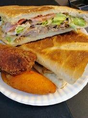 Puerto Rican pressed roast pork sandwich from Puerto