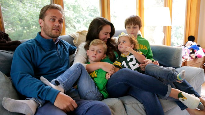 Brandon Grant, left, talks about his family hosting Japanese Packers fans for the game against the Cincinnati Bengals on Sept. 24. The family includes, from left, Jameson, Ashley, Lucy and Christopher.