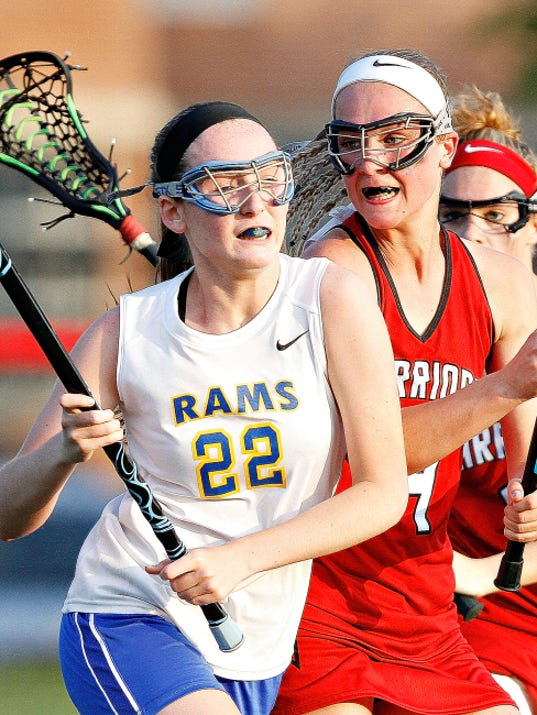 Kennard-Dale's Morgan Day moves the ball down the field as Susquehannock's Gena Speights defends during the York-Adams League girls' lacrosse championship game at Susquehannock High School on Thursday. Day had three goals and two assists in the Rams' 14-11 win.