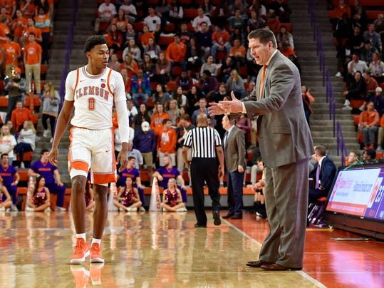 Clemson head coach Brad Brownell, right, talks to Clyde Trapp during the first half of an NCAA college basketball game against Pittsburgh, Thursday, Feb. 8, 2018, in Clemson, S.C.(AP Photo/Richard Shiro)