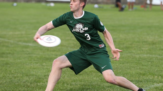 Indianapolis AlleyCats' Cameron Brock makes a pass during their Ultimate Disc game against Madison Radicals at Kuntz Stadium Saturday June 7, 2014.