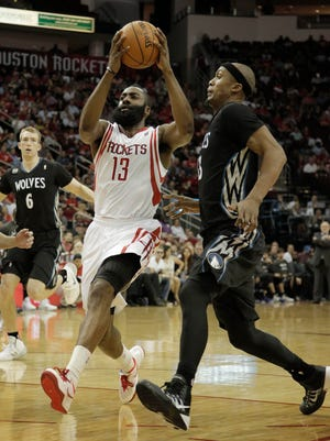 Houston Rockets guard James Harden (13) drives to the basket against Minnesota Timberwolves forward Dante Cunningham (33) during the second quarter at Toyota Center.