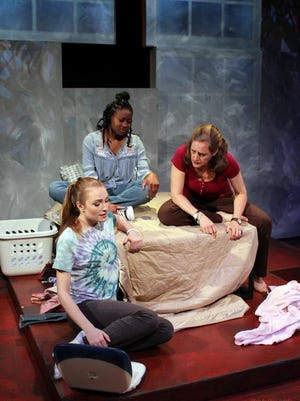 "Lis (Christine Elliott), Victoria (Ejiro) and Sara (Emily Sutton-Smith) in the World Premiere of ""Out of Orbit"" by Jennifer Maisel at Williamston Theatre."