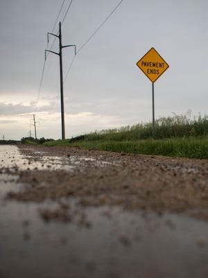 The Pavement Ends sign is shown on 471st Avenue in Sioux Falls, S.D. Wednesday, June 13, 2018.